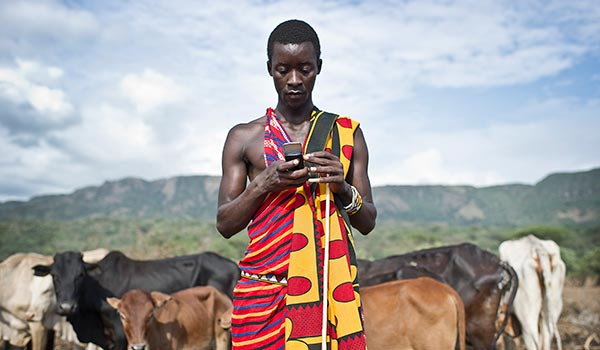 african guy with cows